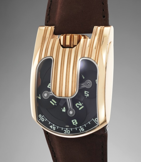 A rare and original pink gold wristwatch with three-dimensional satellite hour display and power reserve