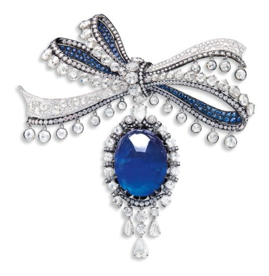 A Versatile Cabochon Sapphire and Diamond Brooch/Pendant/ Ring