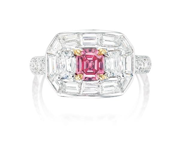A Fancy Vivid Purplish Pink Diamond and Diamond Ring