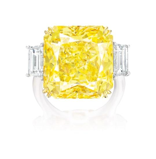 A Fancy Vivid Yellow Diamond and Diamond Ring