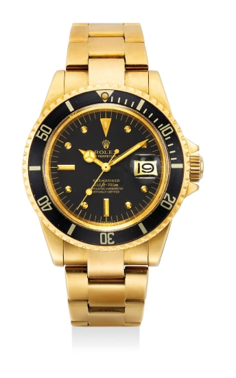 A very fine and rare yellow gold diver's wristwatch with date, center seconds, bracelet, guarantee and fitted presentation box.