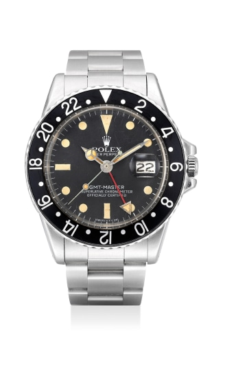 A fine and attractive stainless steel dual-time wristwatch with sweep center seconds, date, 24-Hour indication and bracelet