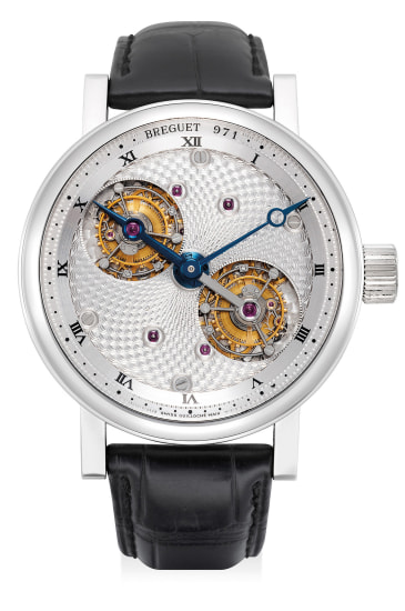 """A very fine and attractive platinum oversized wristwatch with double rotating tourbillon escapement and """"guilloche"""" dial"""