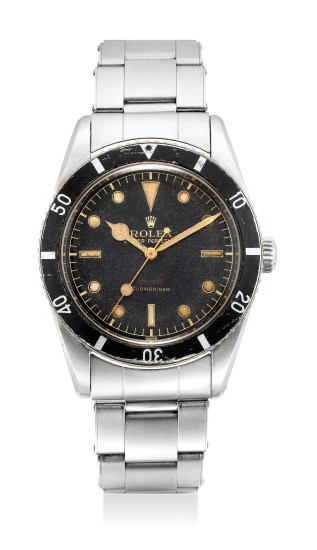 A fine, rare and attractive stainless steel diver's wristwatch with black lacquered dial red depth reading, sweep center seconds, no crown guards and bracelet