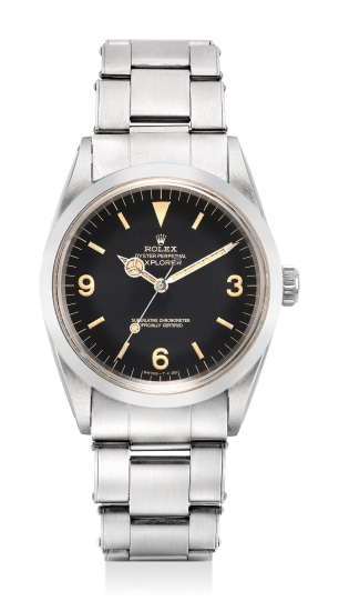 A very fine, attractive and rare stainless steel wristwatch with sweep center seconds, black glossy dial and bracelet