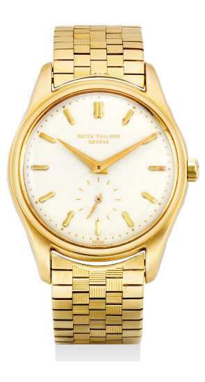 An extremely elegant, refined  and rare yellow gold automatic wristwatch with 1st series enamel dial and Gay Frères bracelet