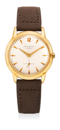 An attractive and rare yellow gold wristwatch with small center seconds