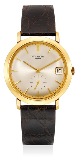 A fine and attractive yellow gold wristwatch with date