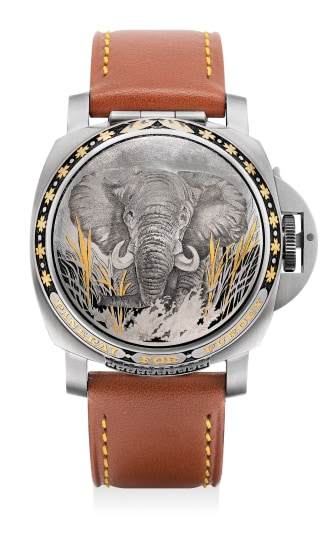 An attractive limited edition stainless steel and inlaid gold wristwatch with date, small seconds and concealed dial, made for Purdey, numbered 99 of a limited edition of 100 pieces.