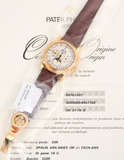 A fine and attractive yellow gold perpetual calendar chronograph wristwatch with 24-hour indication, moon phases, additional case back, setting pin, Certificate of Origin and presentation box, single sealed