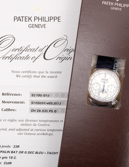 An extremely fine and rare limited edition white gold perpetual calendar chronograph wristwatch with white dial, day/night indication, leap year aperture, Certificate of Origin and presentation box, factory sealed