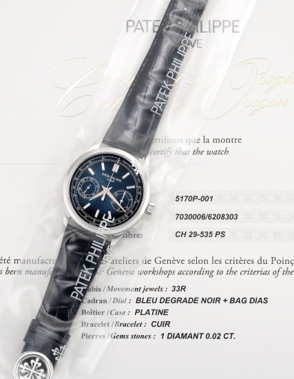 """A very fine and attractive platinum chronograph wristwatch with baguette diamond indexes, """"fumé"""" dial, certificate of origin and fitted presentation box, single sealed"""