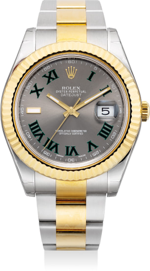 A large yellow gold and stainless steel wristwatch with center seconds, date, bracelet, guarantee and box