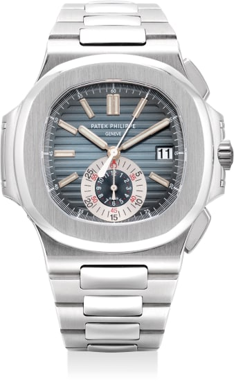 A very fine and attractive stainless steel flyback chronograph wristwatch with date, bracelet and Certificate of Origin