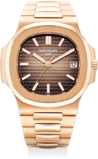 A very fine and attractive pink gold wristwatch with sweep center seconds, date, bracelet and certificate of origin