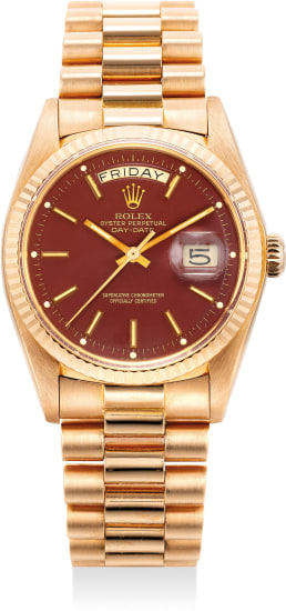 """An extremely fine and attractive pink gold wristwatch with sweep centre seconds, day, date, burgundy lacquer """"Stella"""" dial and bracelet"""