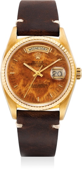 "An attractive and rare yellow gold wristwatch with sweep center seconds, day, date and ""wood"" dial"