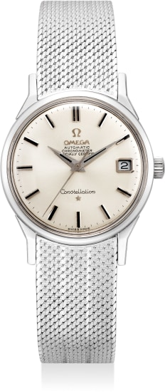 A very fine and attractive white gold wristwatch with date, sweep center seconds, bracelet, guarantee and presentation box