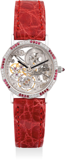 A lady's fine and attractive white gold, diamond and ruby-set skeletonized wristwatch