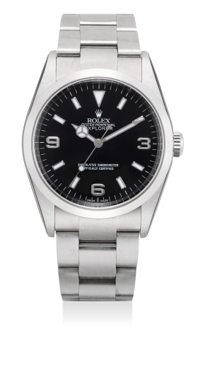 A fine stainless steel automatic wristwatch with sweep center seconds, bracelet, guarantee and box