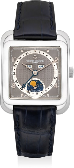 A fine and attractive platinum rectangular-shaped triple calendar wristwatch with retrograde date, moon phases, guarantee and presentation box