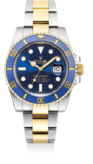A fine and attractive yellow gold and stainless steel diver's wristwatch with date, bracelet, guarantee and presentation box