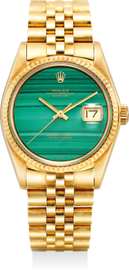 A supremely rare and attractive yellow gold automatic wristwatch with center seconds, date, malachite dial, bracelet and box