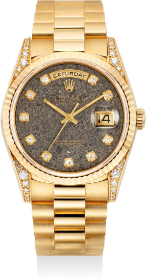 """A fine, attractive and rare yellow gold and diamond-set wristwatch with day, date, sweep center seconds, diamond indexes, """"Jurassic"""" fossil dial, bracelet, guarantee and presentation box"""