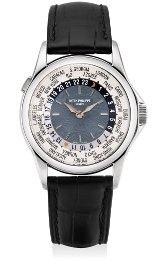 """A fine and attractive platinum world time wristwatch with """"guilloche"""" dial, certificate of origin and presentation box"""