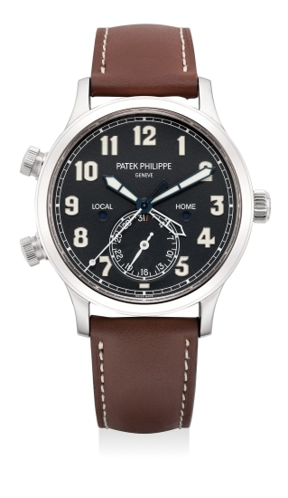A fine and attractive white gold pilot's dual-time wristwatch with date, day and night indicator, certificate of origin and presentation box