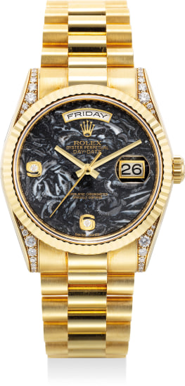 A fine and rare yellow gold and diamond-set wristwatch with sweep center seconds, day, date, fossilized limestone dial, bracelet, guarantee and presentation box