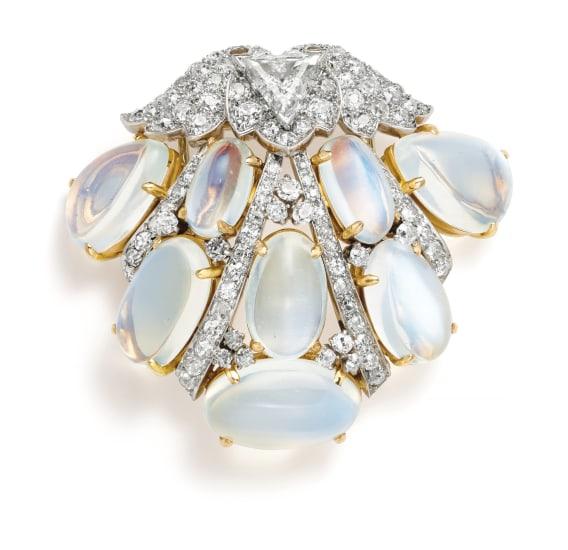 A Diamond, Moonstone, Platinum and Gold Brooch