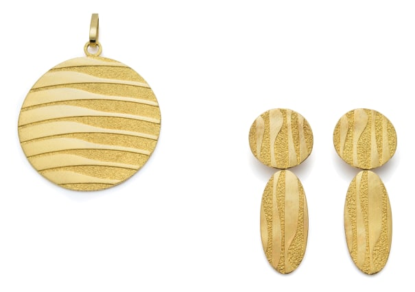 A Pair of Gold Earrings and Pendant