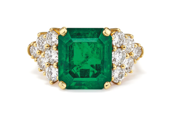 An Emerald, Diamond and Gold Ring
