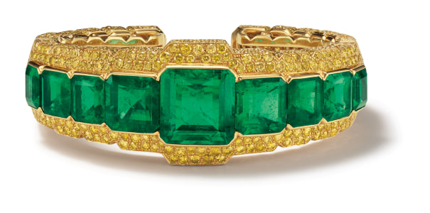 An Emerald, Colored Diamond and Gold Bracelet