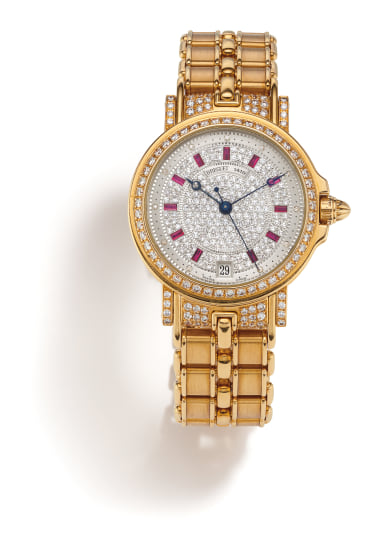 A Diamond, Ruby and Gold Wristwatch