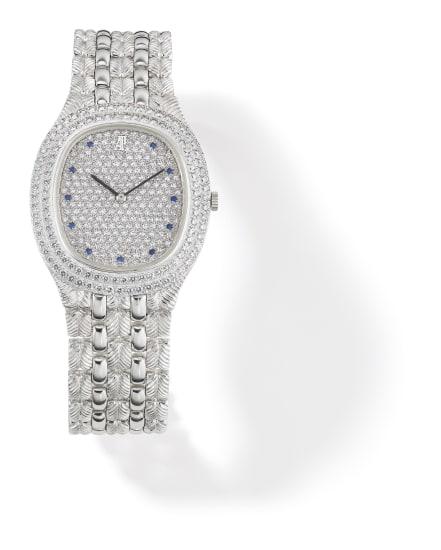 A Diamond, Sapphire and Gold Wristwatch