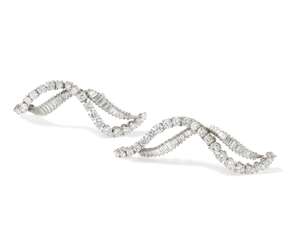A Pair of Diamond, Platinum and Gold 'Flame' Brooches