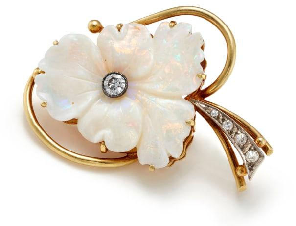 An Opal, Diamond and Gold Brooch
