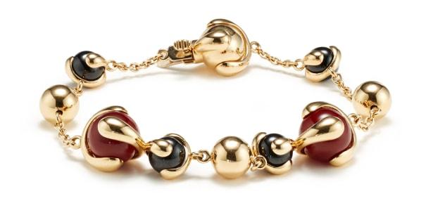 A Carnelian, Jade and Gold 'Cardan' Bracelet