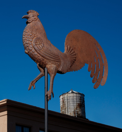 A large full-bodied molded and cast-iron Rooster weathervane