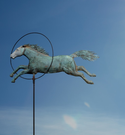 "A full-bodied molded copper and zinc ""Horse and Hoop"" weathervane"