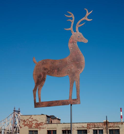 A primitive sheet iron stag weathervane