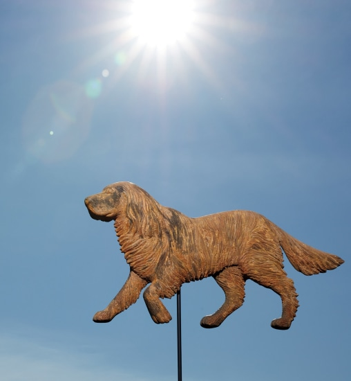 A carved painted and giltwood dog weathervane mold