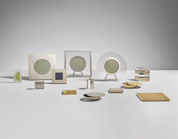 Group of five picture frames, four cigarette cases, two ashtrays, one lidded box and one lighter
