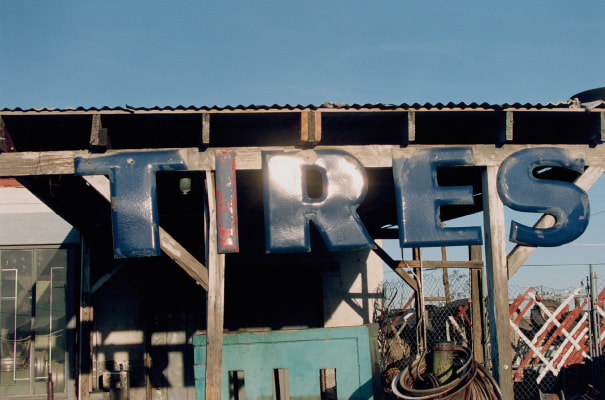 Untitled (tire sign)