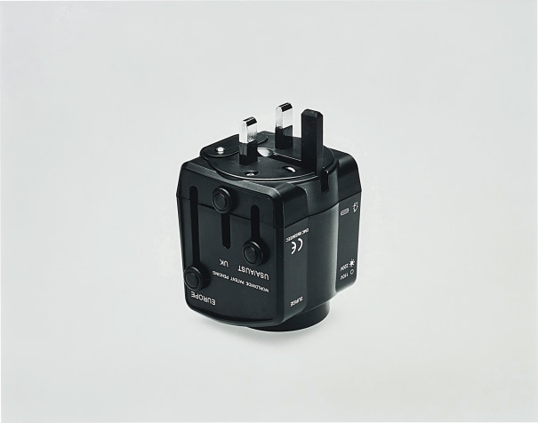 Universal Travel Adaptor, Scorpio Distributors Ltd., Unit DZ, West Sussex, Great Britain, Product number TXR770000, Power Rating: 6A Max 125/250Vac, With Built-In Surge Protector, With Safety Shutters, Surge Indicator Light 110Vac or 220Vac Light Indicator, Built-In 13A Fuse, Testing based on International Standard IEC 884-2-5 Witnessed by TUV, CE EMC Approval, Photography by the Douglas M. Parker Studio, Los Angeles, California, December 15, 2005.