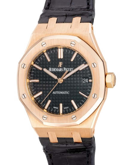 A fine and attractive pink gold wristwatch with center seconds, date, warranty and box