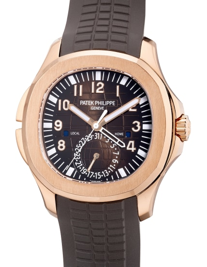 A fine and rare pink gold dual time wristwatch with center seconds, date, day and night indication, Certificate of Origin and presentation box