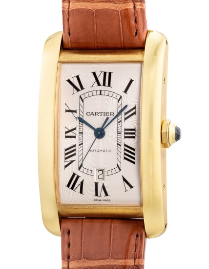 A fine, attractive and extra large yellow gold rectangular-shaped wristwatch with center seconds, date, warranty and box
